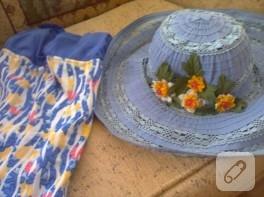 İğne oyası yapılmış çiçeklerle süslü şapka