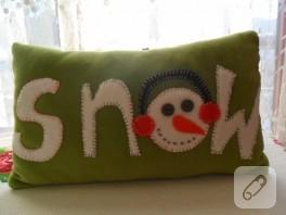 Kardan adamlı yastık