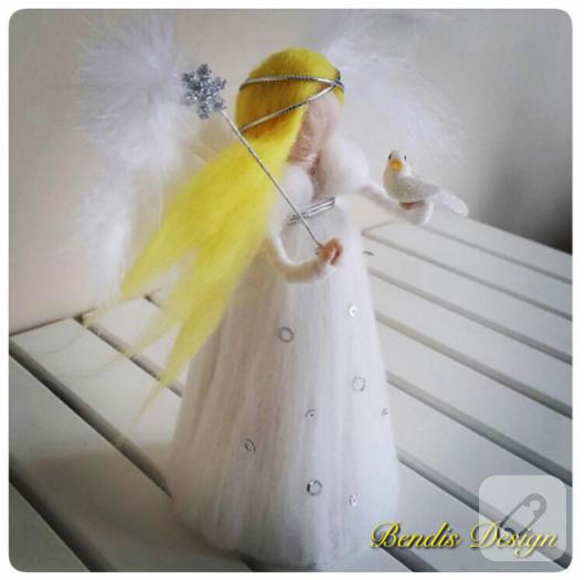 beyaz-elbiseli-sari-sacli-keceleme-melek-kiz